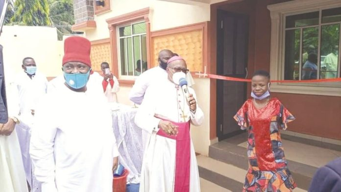 Archbishop Okeke builds house for physically-challenged girl in Anambra