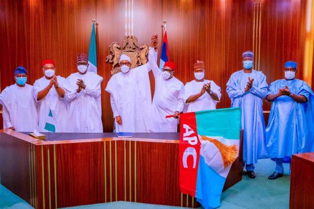 Anambra 2021 Buhari Receives Andy Ubah, Hands Him APC Flag